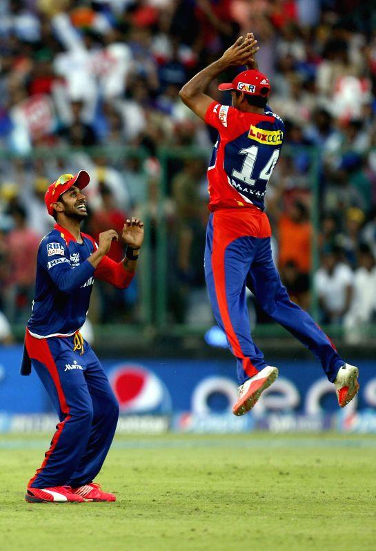 Delhi Daredevils celebrate fall of a wicket during an IPL-2015 match between Delhi Daredevils and Rajasthan Royals at Feroz Shah Kotla, in New Delhi, on April 12, 2015. - Feroz Shah Kotla