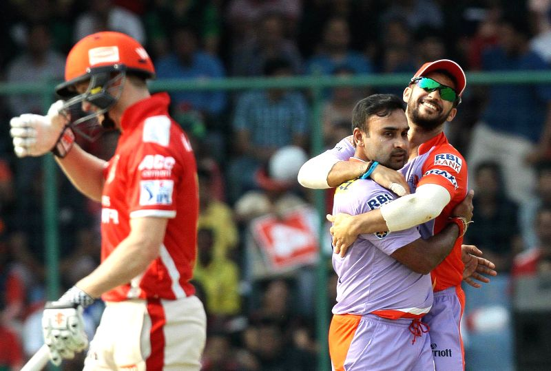 Delhi Daredevils celebrate fall of a wicket during an IPL 2015 match between Delhi Daredevils and Kings XI Punjab at the Feroz Shah Kotla stadium in New Delhi, on May 1, 2015. - Feroz Shah Kotla