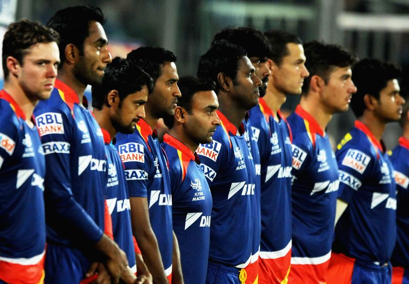 Delhi Daredevils players pay tribute to the victims of Nepal earthquake ahead of an IPL -2015 match between Delhi Daredevils and Royal Challengers Bangalore at Feroz Shah Kotla stadium in ... - Feroz Shah Kotla