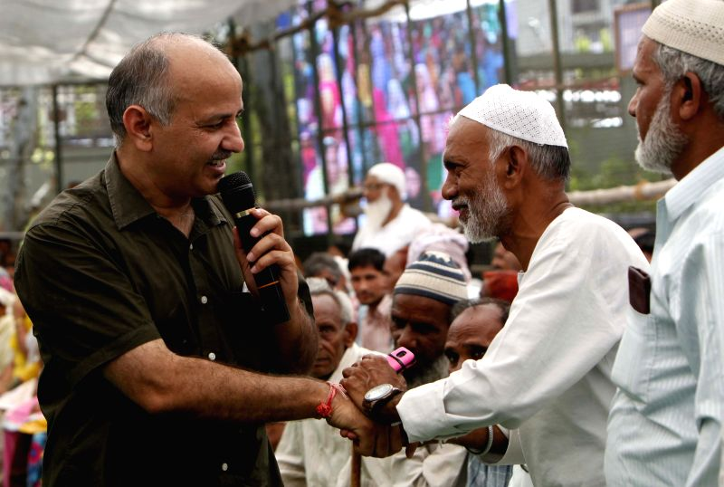 Delhi Deputy Chief Minister Manish Sisodia interacts with people during a programme organised to seek public suggestions on Delhi budget in East Delhi on April 19, 2015. - Manish Sisodia