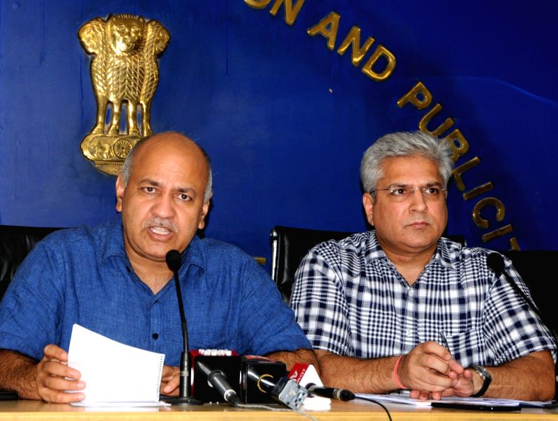 New Delhi: Delhi Deputy Chief Minister Manish Sisodia accompanied by Transport Minister Kailash Gahlot, addresses a press conference at the Delhi Secretariat, on July 11, 2019.