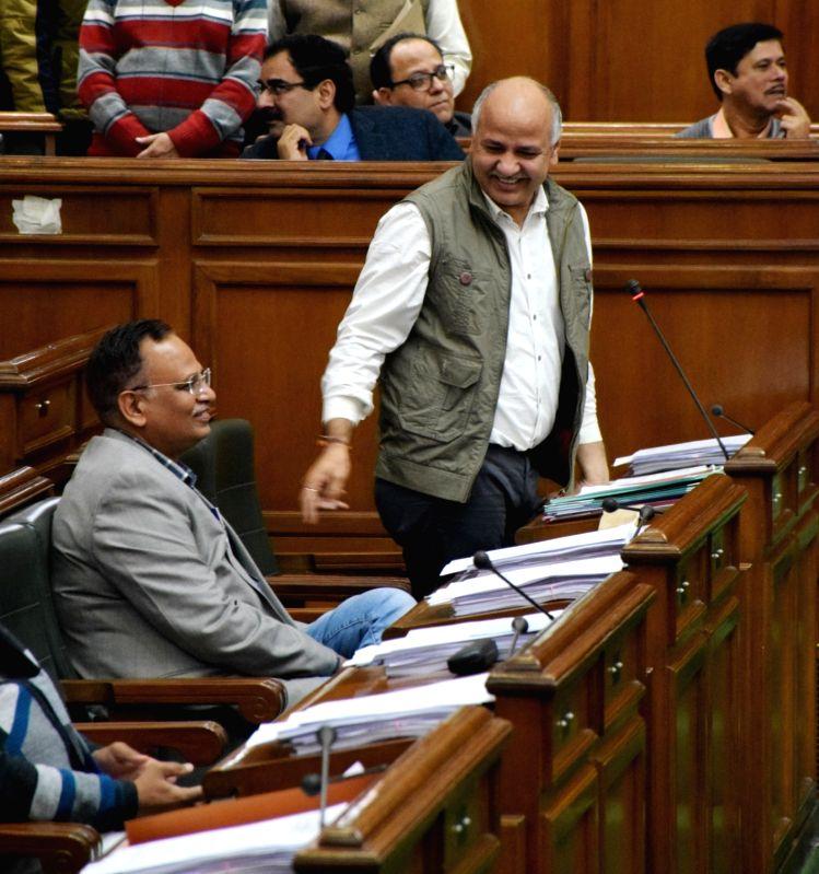 New Delhi: Delhi Deputy Chief Minister Manish Sisodia and Health Minister Satyendar Jain during budget session of Delhi Legislative Assembly on Feb 25, 2019.