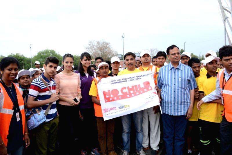 Delhi Health and Family Welfare Minister Satyendar Jain at the flagging-off ceremony of a marathon at Jawaharlal Nehru Stadium in New Delhi, on April 12, 2015. Also seen Miss India 2014 ... - Satyendar Jain