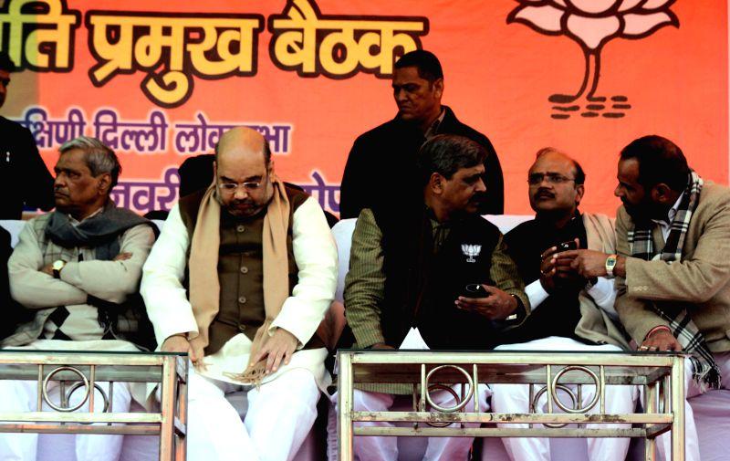Delhi in-charge of BJP Prabhat Jha, BJP chief Amit Shah, Delhi BJP chief Satish Upadhyay and South Delhi MP Ramesh Bidhuri during a party rally in New Delhi, on Jan 25, 2015. - Amit Shah and Satish Upadhyay