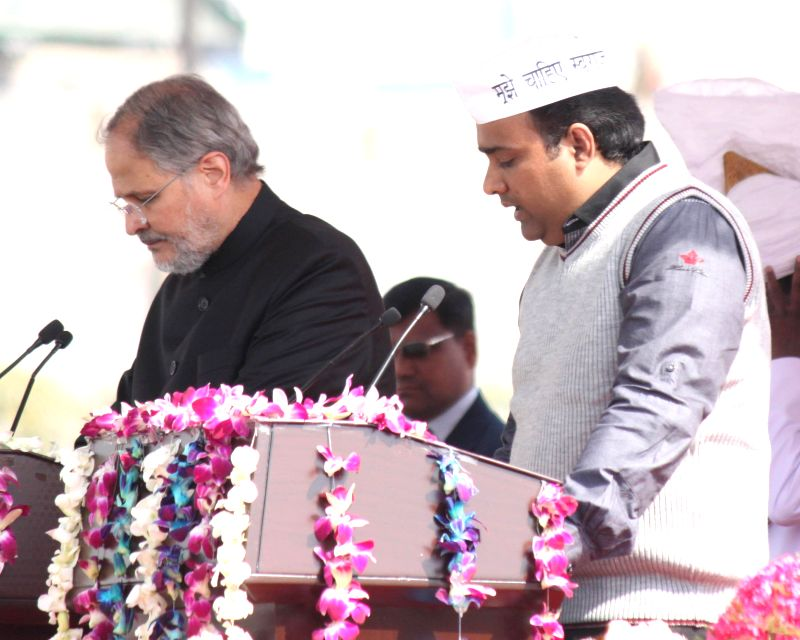 Delhi Lieutenant Governor Najeeb Jung administers oath of office to the Aam Aadmi Party (AAP) leader Asim Mohammad Khan as a minister in the Kejriwal government at Ramlila Maidan in New ... - Asim Mohammad Khan