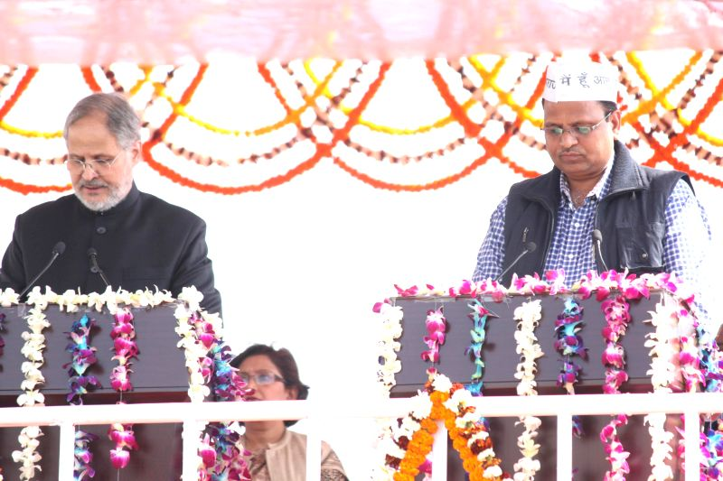 Delhi Lieutenant Governor Najeeb Jung administers oath of office to the Aam Aadmi Party (AAP) leader Satyendra Jain as a minister in the Kejriwal government at Ramlila Maidan in New Delhi, - Satyendra Jain