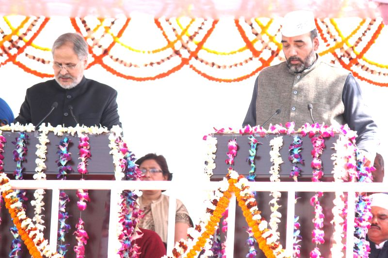 Delhi Lieutenant Governor Najeeb Jung administers oath of office to the Aam Aadmi Party (AAP) leader Gopal Rai as a minister in the Kejriwal government at Ramlila Maidan in New Delhi, on .. - Gopal Rai