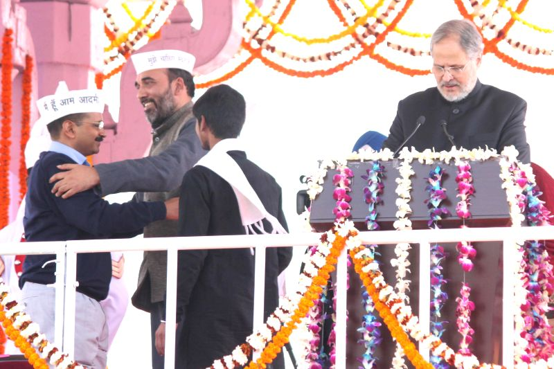Delhi Lieutenant Governor Najeeb Jung with Aam Aadmi Party (AAP) leader Gopal Rai and Delhi Chief Minister Arvind Kejriwal at Ramlila Maidan in New Delhi, on Feb 14, 2015. - Arvind Kejriwal and Gopal Rai