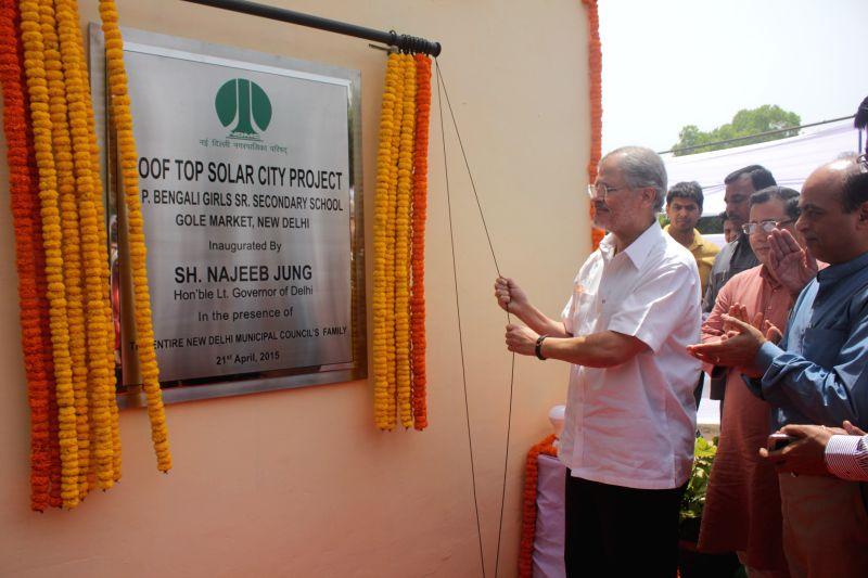 Delhi Lieutenant Governor Najeeb Jung inaugurates `Roof Top Solar City Project` at a Delhi School, on April 21, 2015.