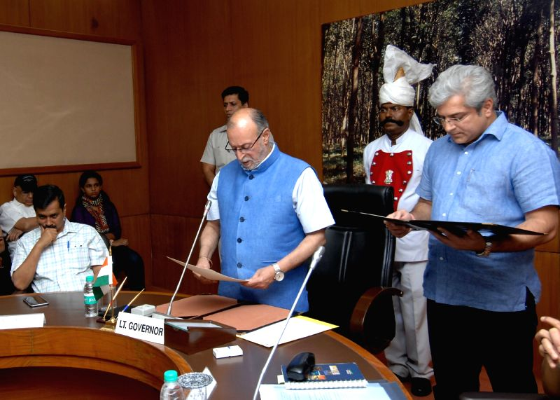 New Delhi:Delhi Lt. Governor Anil Baijal administers oath of office and secrecy to Kailash Gahlot as Minister of Government of NCT of Delhi at Raj Niwas in New Delhi on May 19, 2017.