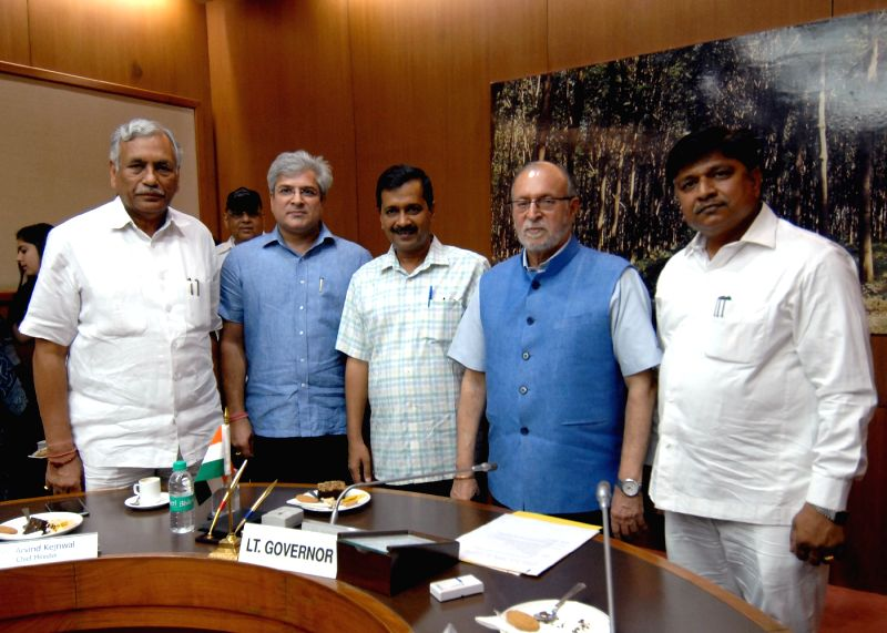 New Delhi:Delhi Lt. Governor Anil Baijal, Speaker Ram Niwas Goel and Chief Minister Arvind Kejriwal with newly elected Ministers of Government of NCT Rajendra Pal Gautam and Kailash Gahlot at Raj ... - Ram Niwas Goel and Arvind Kejriwal
