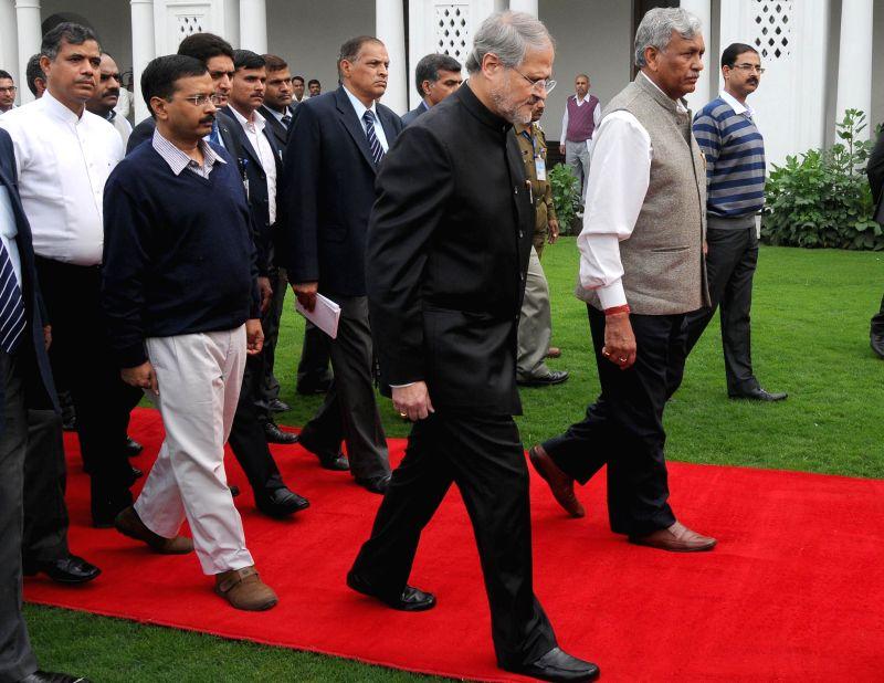 Delhi  Lt. Governor Najeeb Jung, Delhi Chief Minister Arvind Kejriwal and Delhi Legislative Assembly Speaker Ram Niwas Goel proceed towards the Delhi Legislative Assembly on Feb 24, 2015. - Arvind Kejriwal