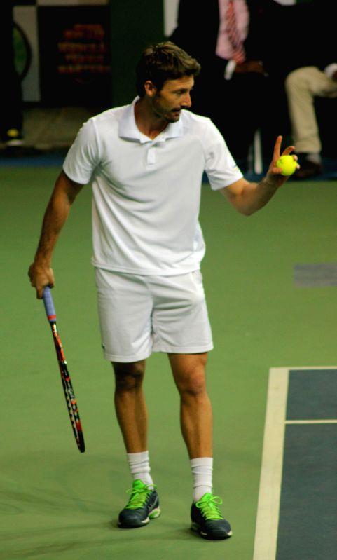Delhi player Juan Carlos Ferrero during Champions Tennis League (CTL) final match against Pat Cash of Pune at R.K. Khanna Tennis Stadium in New Delhi, on Nov 26, 2014.