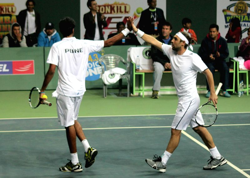 Delhi players Kevin Anderson and Sanam Singh  during Champions Tennis League (CTL) final match (men's doubles) against Pune players Marcos Baghdatis and Saketh Myneni at R.K. Khanna Tennis - Sanam Singh