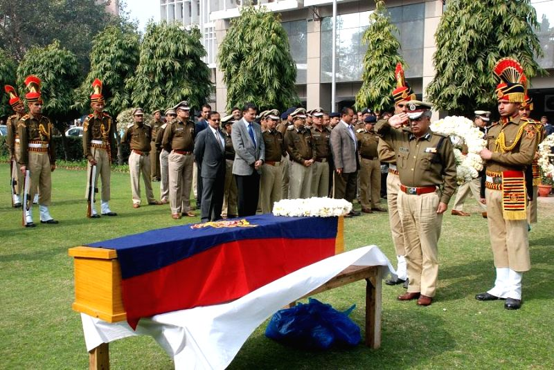 Delhi Police Commissioner B S Bassi pays last respect to late Constable Ajmer Singh at Delhi Police headquarter in New Delhi on Feb. 4, 2015. The police constable, who got injured on ...