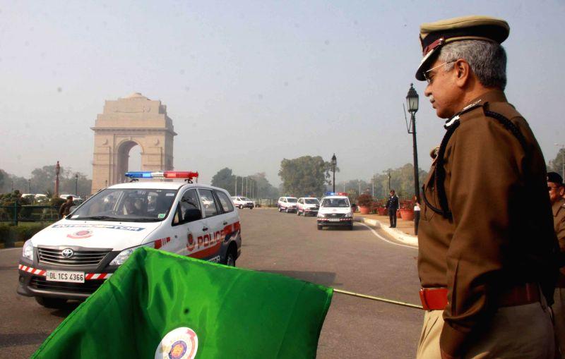 Delhi Police Commissioner BS Bassi flags-off new interceptor vehicles in New Delhi on on Dec 17, 2014.