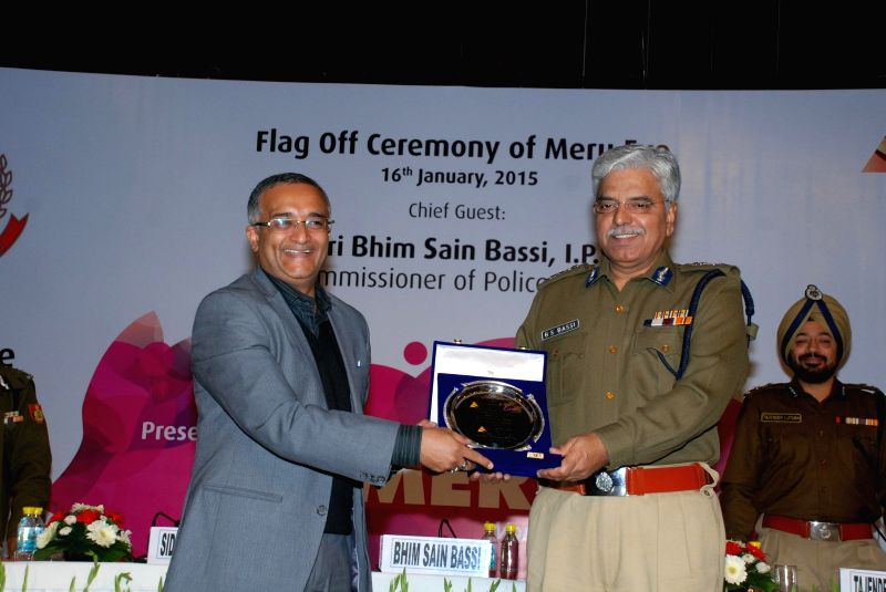 Delhi Police Commissioner BS Bassi during a programme organised to flag-off  'Meru Eve'  - cabs driven by women in New Delhi, on Jan 16, 2015.