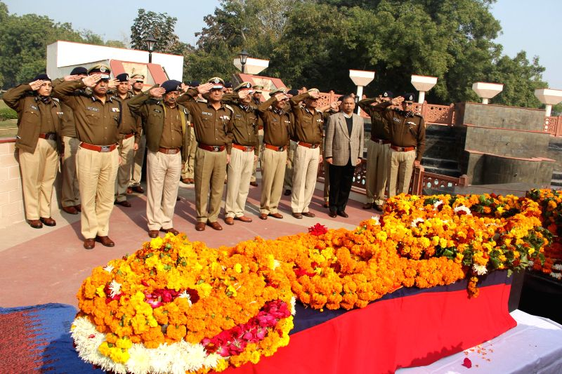 Delhi Police Commissioner BS Bassi and other policemen pay tribute to the policemen who made supreme sacrifices on the line of duty at Martyrs Memorial New Police Line Parade Ground ...