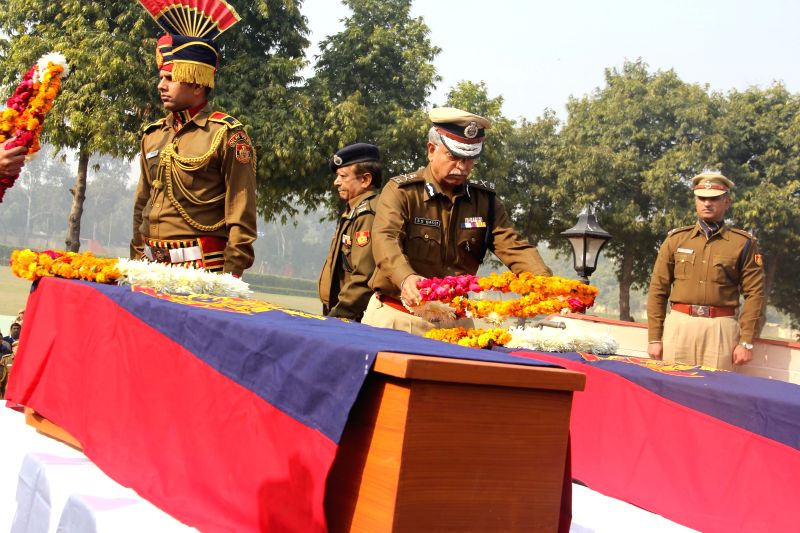 Delhi Police Commissioner BS Bassi pays tribute to the policemen who made supreme sacrifices on the line of duty at Martyrs Memorial New Police Line Parade Ground Kingsway Camp in New ...