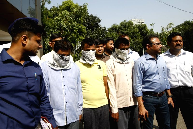 :New Delhi: Delhi Police crime branch officials with the three persons arrested in connection with CBSE class Class XII Economics paper leak, in New Delhi on April 7, 2018. .