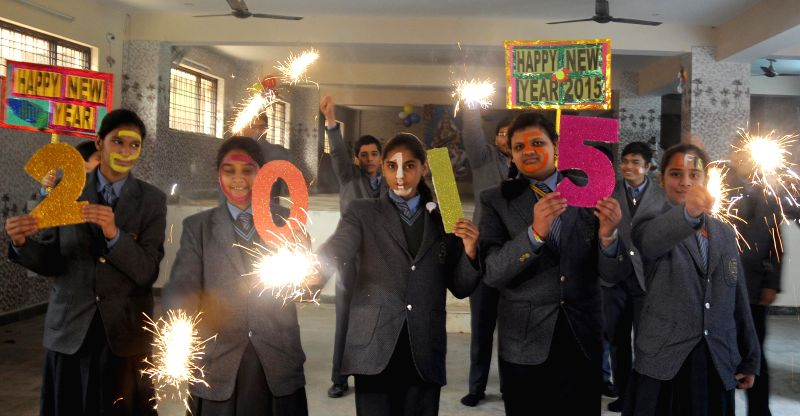 Delhi students welcome 2015 in New Delhi, on Dec 31, 2014.