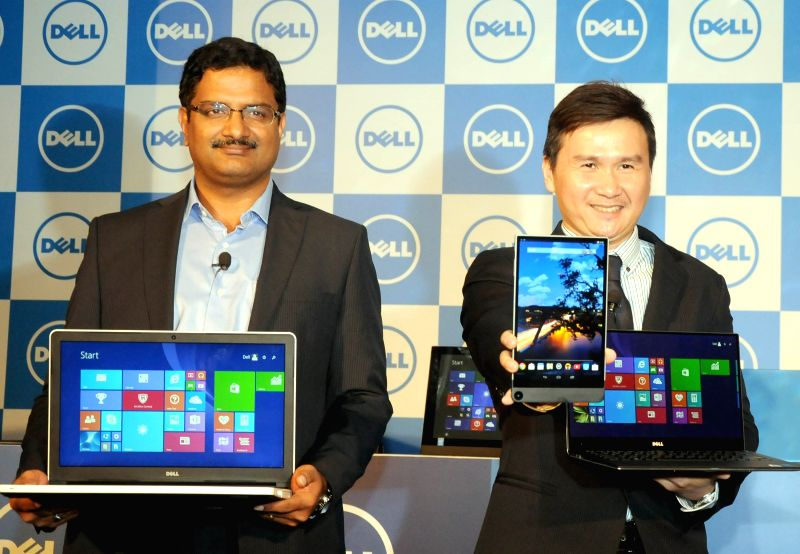 Dell India Vice President (Consumer and Small Business) P. Krishna Kumar (L) and Dell Inc. Vice President (Consumer and Small Business) Ray Wah (R) launch a new products at a press ... - P. Krishna Kumar