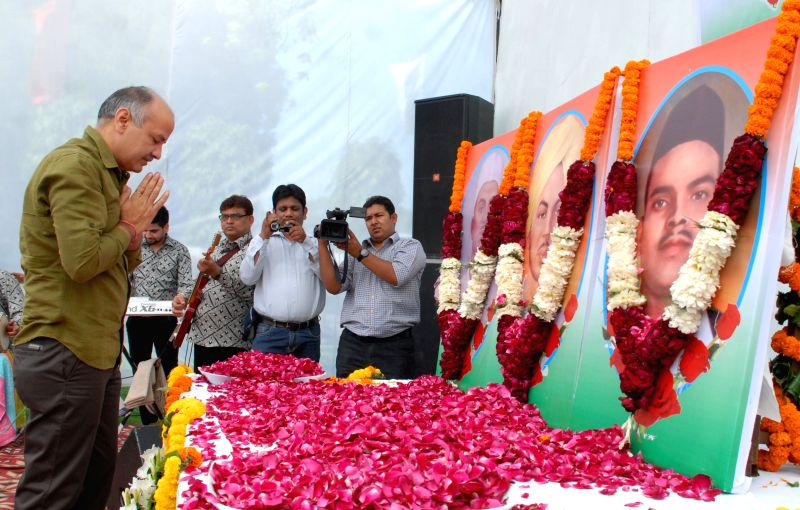 Deputy Chief Minister of Delhi Maish Sisodia  pays tribute to Shaheed Bhagat Singh, Rajguru and Sukhdev during a programme organised to celebrate Shaheed Diwas in New Delhi, on March 23, ... - Bhagat Singh