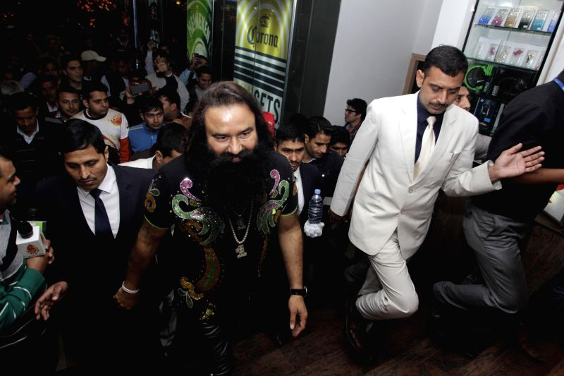 Dera Saccha Sauda chief Gurmeet Ram Rahim Singh arrives at a cinema theatre to promote his upcoming film `MSG - The Messenger of God` in New Delhi, on Feb 12, 2015.