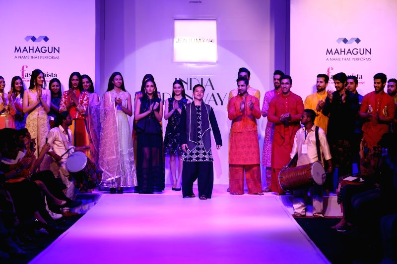 Designer Jenjum Gadi with models during the fourth season of the India Runway Week, Spring Summer Collection - 2015 in New Delhi, on April 10, 2015.