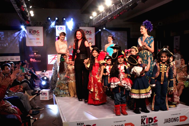 Designer Ritu Beri with kids during her show at India Kids Fashion Week 2015, in New Delhi on March 01, 2015.