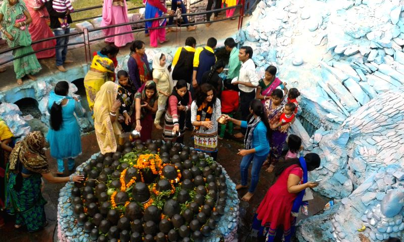 Devotees worship Lord Shiv on Maha Shiv Ratri at a temple in Preet Vihar, New Delhi on March 17, 2015.