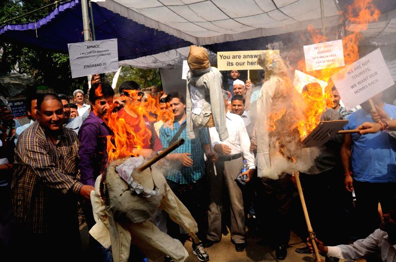 Displaced Kashmiri Pandits, burn effigy representing the Kashmiri separatists for opposing government`s plan to build townships for Kashmiri Pandits in New Delhi on April 11, 2015.