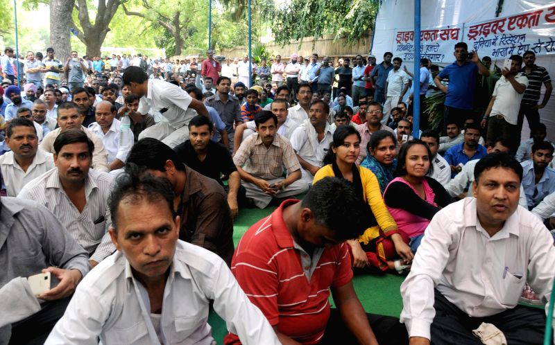 Drivers of app based taxis stage a demonstration at Jantar Mantar to press for their demands in New Delhi, on June 8, 2015.