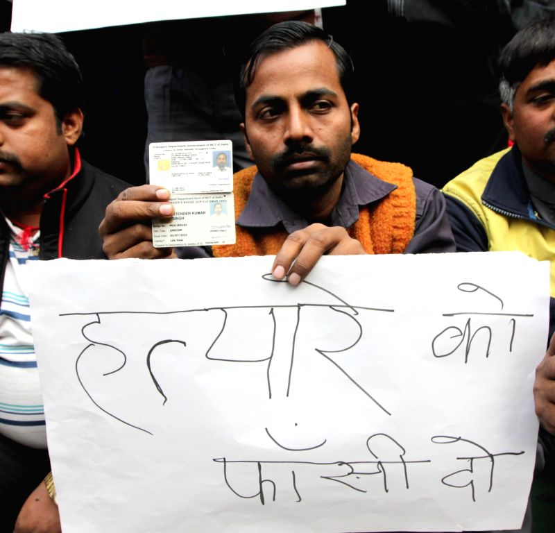 Drivers of the global cab company Uber  stage a demonstration at Jantar Mantar in New Delhi, on Dec 12, 2014.