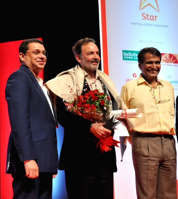 Executive Co-Chairman of NDTV Group Dr Prannoy Roy receives the 2015 RedInk Award for Lifetime Achievement for Excellence in Journalism from  Star India CEO Uday Shankar in New Delhi.