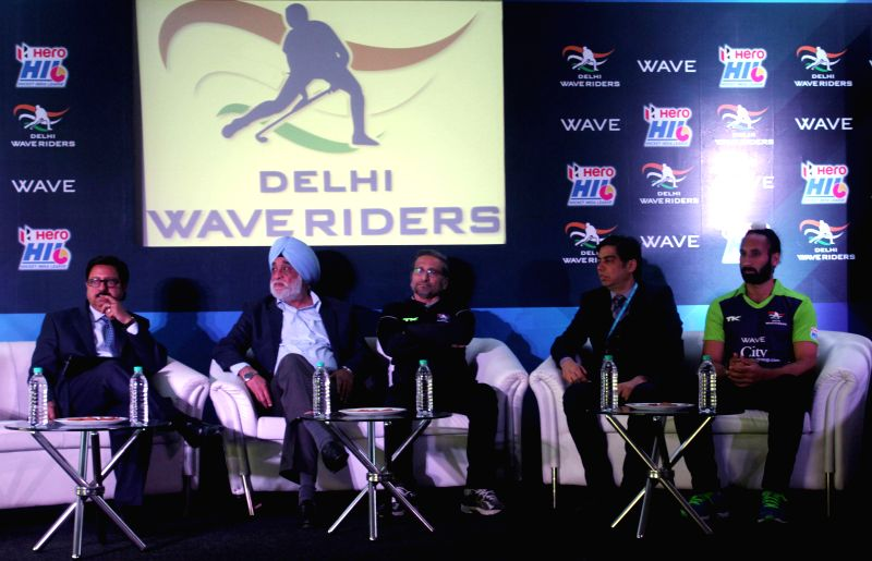 Executive Directer of Wave Group Amar Sinha, former hockey player Ajit Pal Singh, the coach of Delhi Waveriders Cedric D'Souza during a press conference in New Delhi, on Jan 19, 2015. - Group Amar Sinha and Ajit Pal Singh