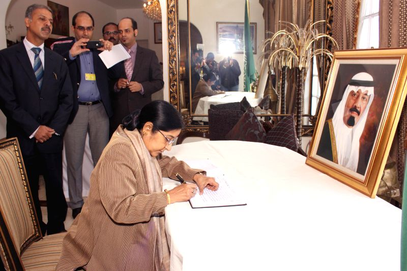 New Delhi : External Affairs Minister Sushma Swaraj signs the condolence book for Saudi Arabia's King Abdullah at the residence of Ambassador of Saudi Arabia to India Dr. Saud Alsatilt on Jan. 27, ... - Sushma Swaraj