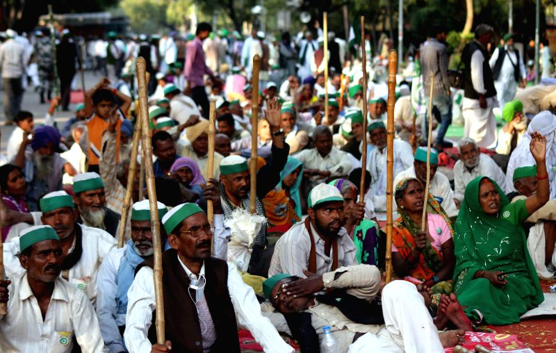 Farmers participate in a demonstration against the land acquisition bill at Jantar Mantar in New Delhi, on March 20, 2015.