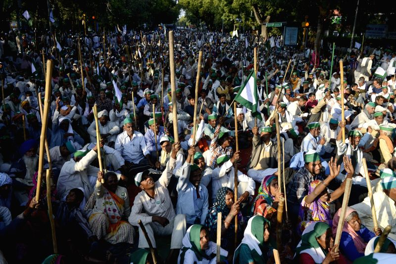 Farmers participate in a rally organised by the members of the All India Coordination Committee of Farmers' Movement to protest against the land acquisition bill in New Delhi on March 18, ...