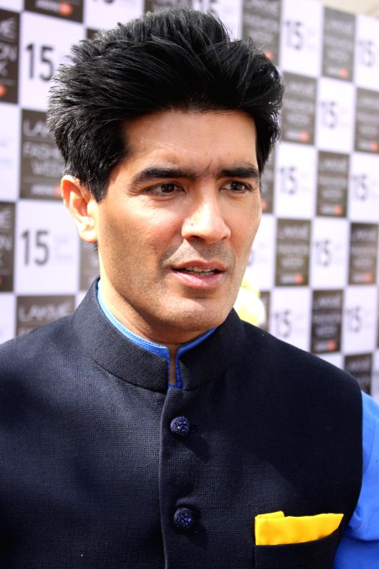 Fashion designer Manish Malhotra during a press conference regarding Lakme Fashion Week, in New Delhi on Feb 26, 2015. - Manish Malhotra