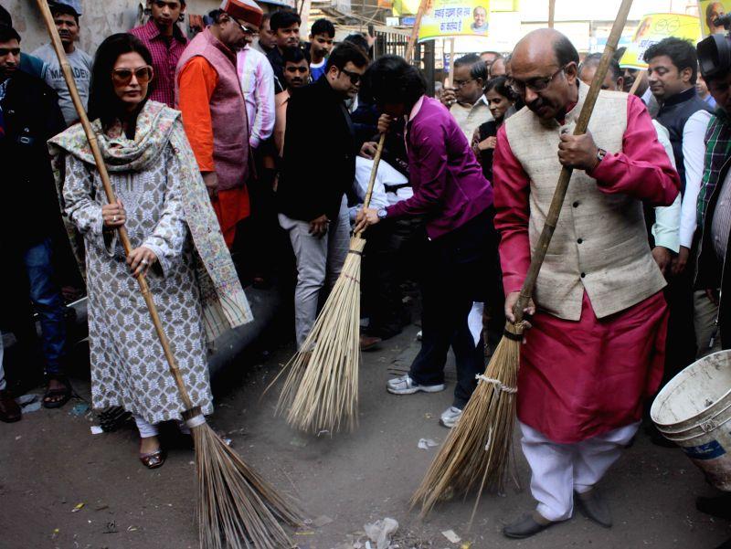 Fashion designer Ritu Beri and BJP leader Vijay Goel participate in Clean India Campaign in New Delhi, on Dec 3, 2014.