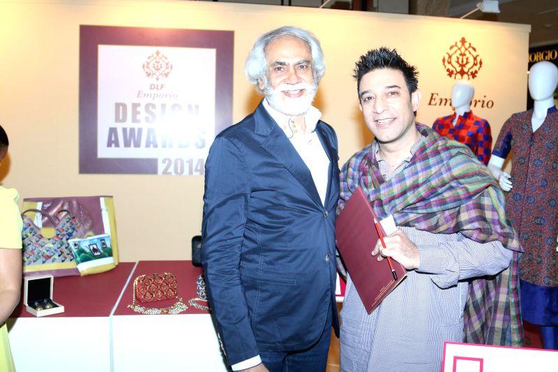 Fashion designer Suneet Verma and Sunil Sethi during the DLF Emporio Design Awards 2014-2015 in New Delhi on Feb 18, 2015. - Suneet Verma