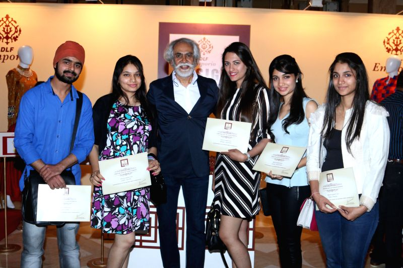 Fashion designer Sunil Sethi with the winners during the DLF Emporio Design Awards 2014-2015 in New Delhi on Feb 18, 2015.
