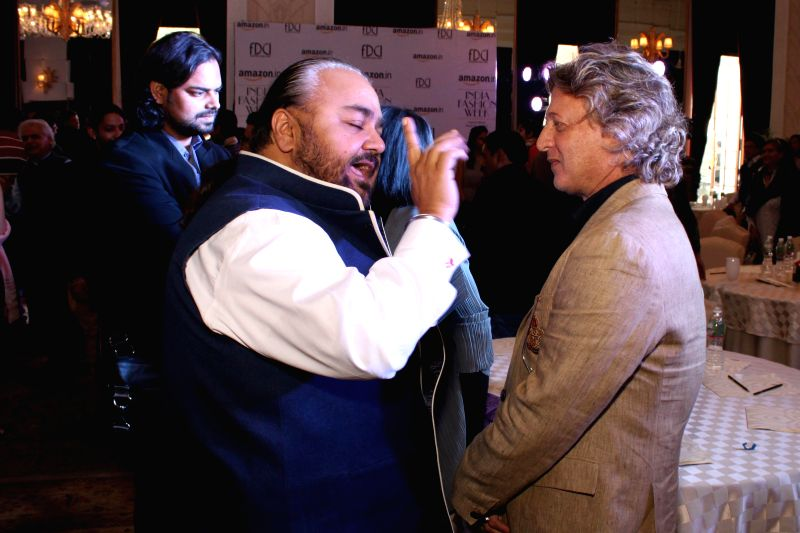 Fashion designers Rohit Bal and J J Valaya during a programme organised to announce Amazon as the title sponsor of the 25th Edition of India Fashion Week in New Delhi on Feb 12, 2015.