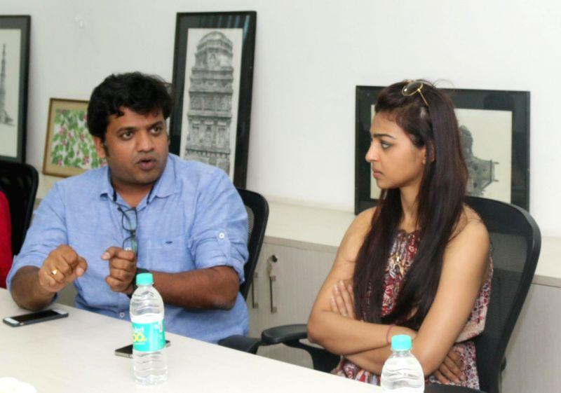 Film producer Harshavardhan G. Kulkarni, actress Radhika Apte during an interview at IANS office in New Delhi on March 16, 2015. - Harshavardhan G. Kulkarni