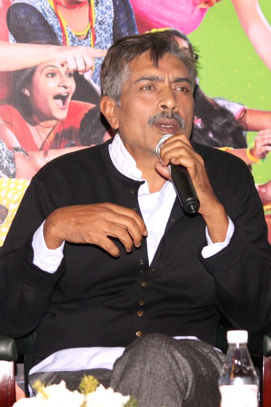 Filmmaker Prakash Jha addresses a press conference to promote his upcoming film `Crazy Cukkad Family`, in New Delhi on Jan. 6, 2015. - Prakash Jha