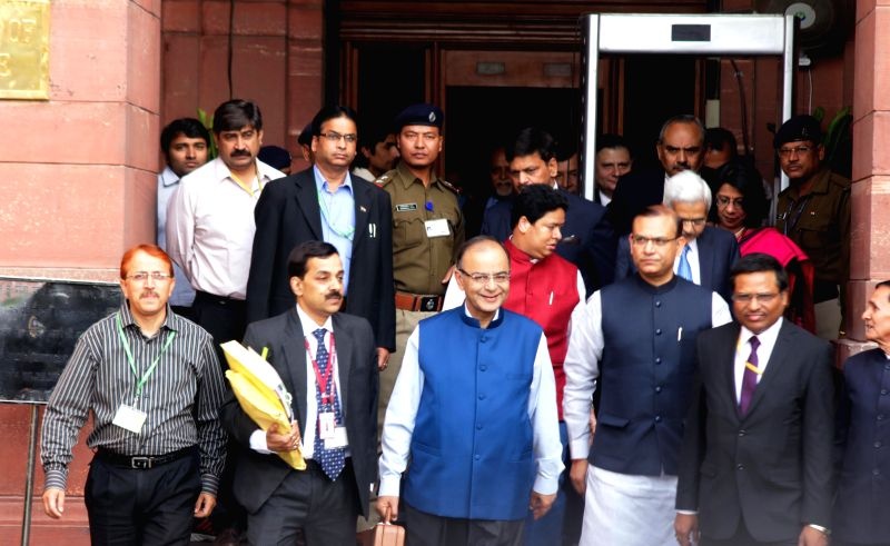 Finance Minister Arun Jaitley and Minister of State for Finance, Jayant Sinha along with the team at North Block before going to Parliament to present the Union Budget in New Delhi on Feb. ... - Arun Jaitley and Jayant Sinha