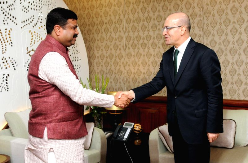 Finance Minister of Turkey Mehmet Simsek calls on the Union Minister of State for Petroleum and Natural Gas (Independent Charge) Dharmendra Pradhan in New Delhi on Feb 24, 2015.