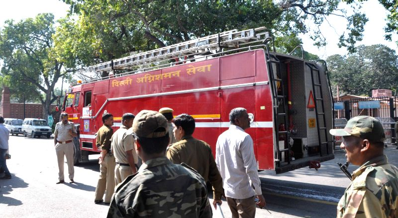 Fire brigade personnel dousing a major fire at Parliament House complex in New Delhi on March 22, 2015.