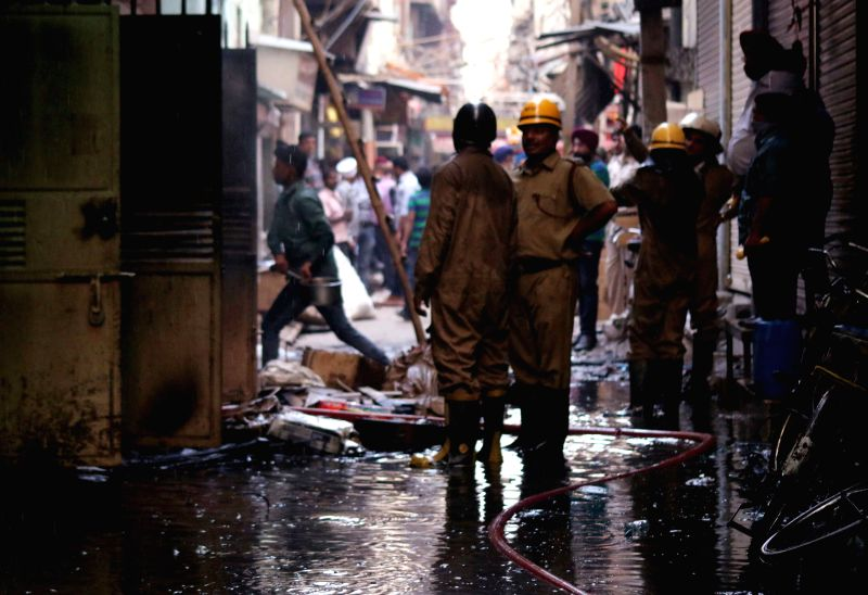 Firemen try hard to douse a fire that broke out in east Delhi's Gandhinagar market on March 31, 2015.